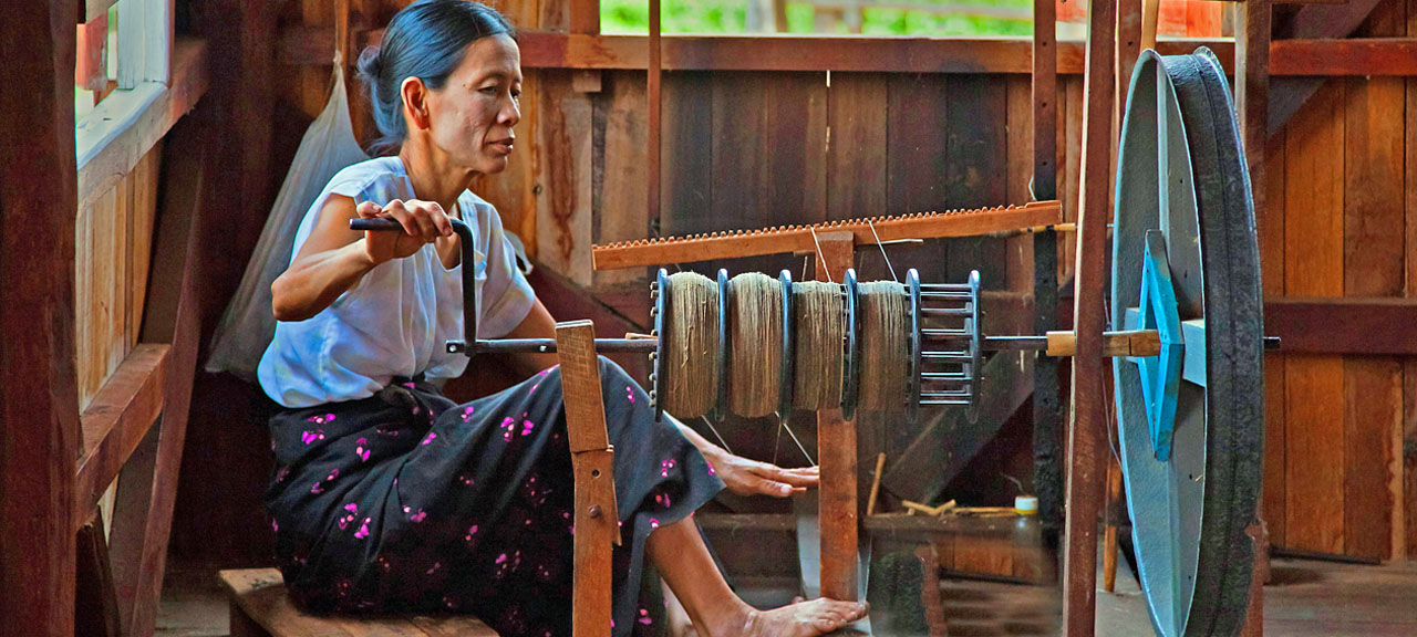 Local woman weaving traditional silk cloth in Myanmar