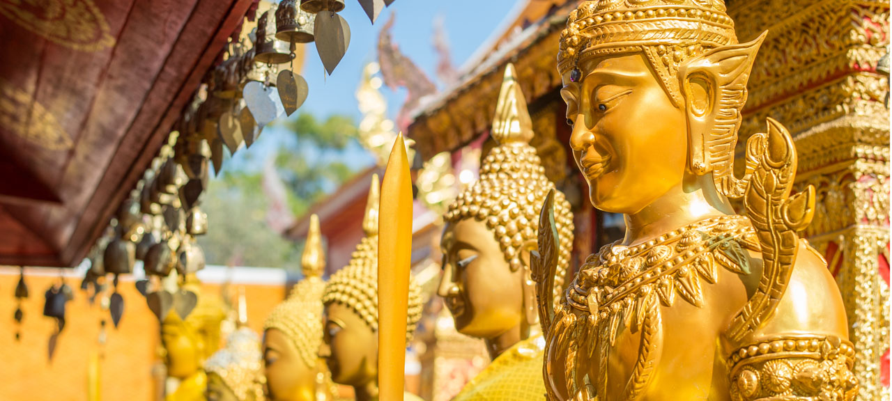 Detail of golden warrior statue from Wat Phra That Doi Suthep in Chiang Mai, Thailand