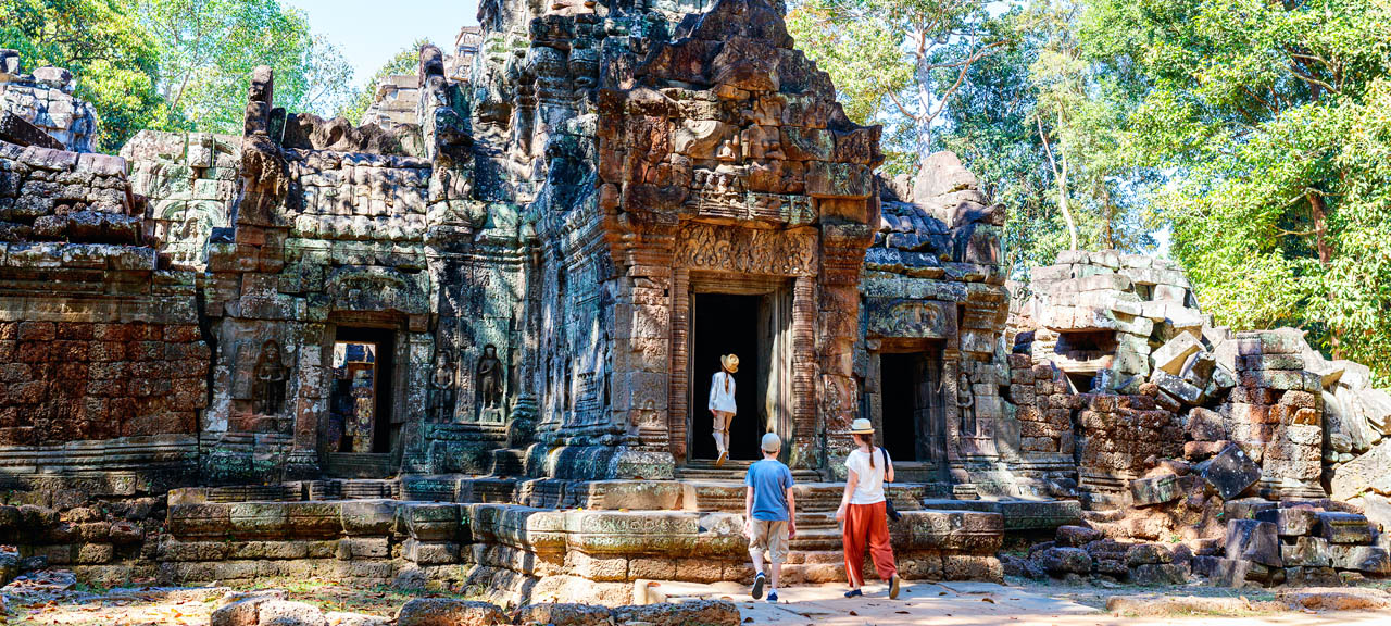 A young family visits the temple complex of Angkor Wat in Cambodia