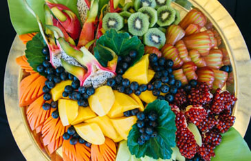 An arrangement of beautiful tropical flowers and fresh fruit at the Amanpuri Resort, Phuket, Thailand