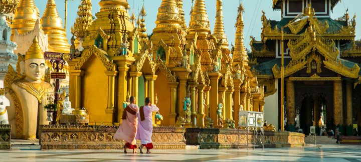 Two Novice Nuns Walking Past Shwedagon Pagoda in Yangon, Myanmar