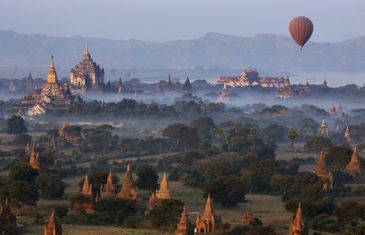 Explore temples in the Bagan area, thousands of temples rise up into the horizon at the time the soft light of golden hour changes to twilight