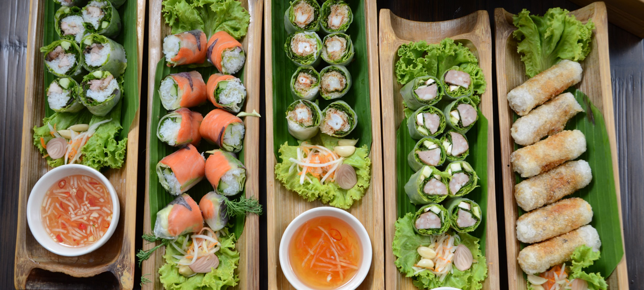 A beautiful arrangement of traditional Vietnamese fresh spring rolls displayed for guests to eat