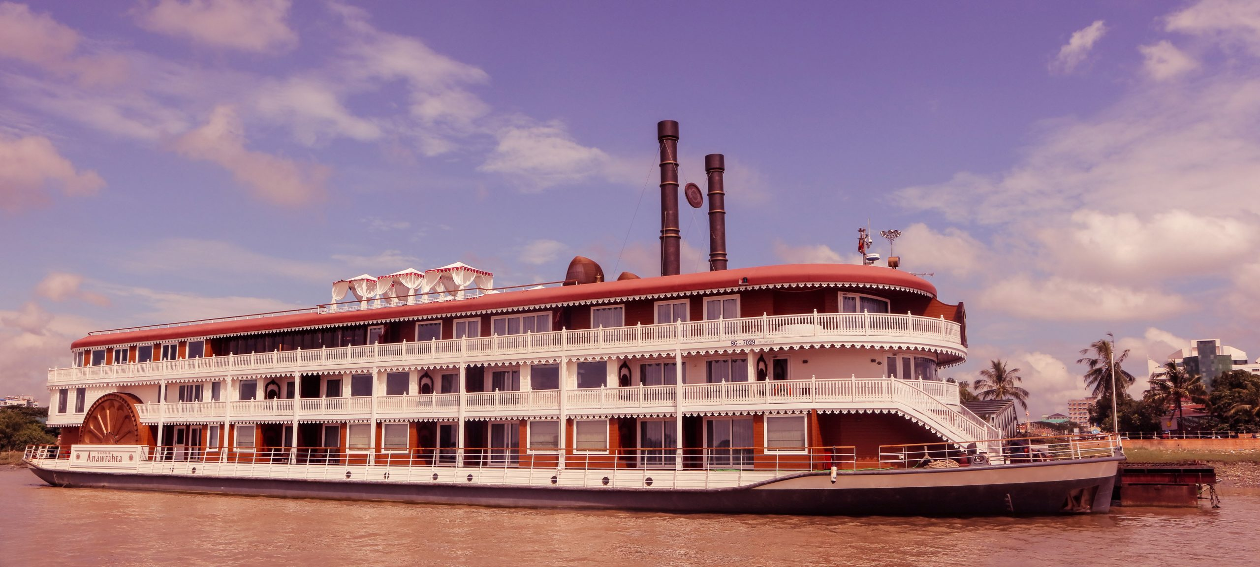 Heritage Line's most luxurious flagship, Heritage Line Anawrahta cruising down the river at sunset