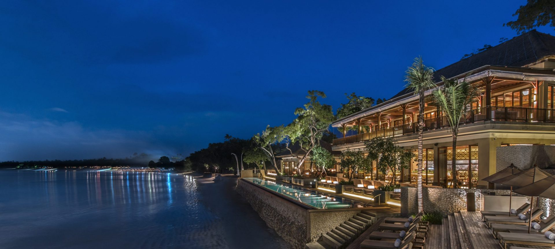 The Jimbaran Bay property at night by the Four Seasons Resort Bali a luxury property overlooking the sea