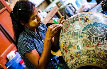 Myanmar woman making a paper mache sculpture