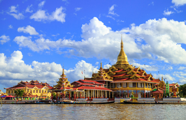 Inle Lake's Phaungdaw Oo Pagoda with blue sky and white fluffy clouds