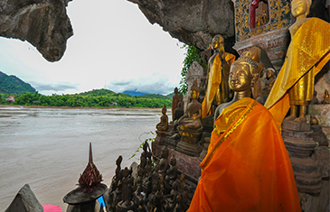 Golden Buddhas by the river in Luang Prabang, Laos