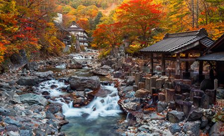 Japanese natural bath by the river in autumn