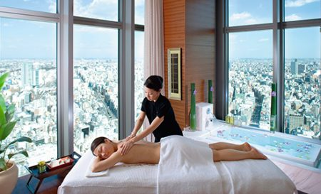 Woman enjoys a massage at blissful pampering at the Mandarin Oriental Tokyo Spa